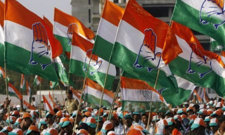congress supporters hold party flags