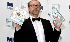 George Saunders, author of 'Lincoln in the Bardo', poses for photographers after winning the Man Booker Prize for Fiction 2017 in London, Britain, October 17, 2017. REUTERS/Mary Turner