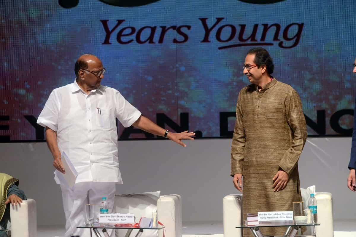 NCP chief Sharad Pawar interacts with Shiv Sena chief Uddhav Thackeray